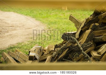 Pile of timber firewood along the forest road