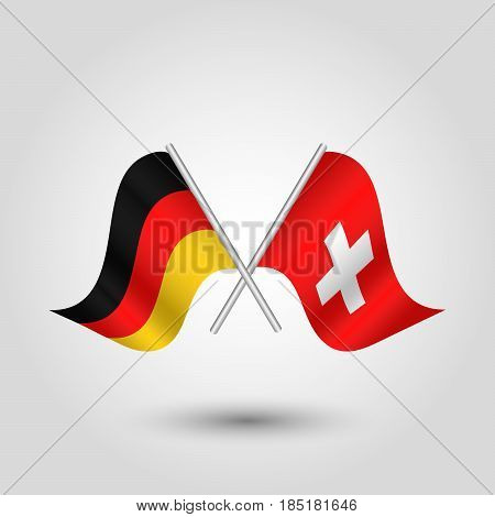 vector two crossed german and swiss flags on silver sticks - symbol of germany and switzerland