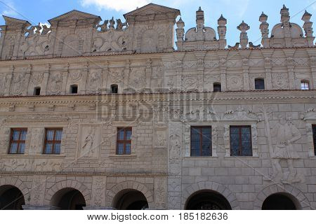 Townhouses under St. Mikolaj and Krzysztof in Kazimierz Dolny on the Vistula River (Poland). Historical tenement houses of the 17th century with an identical façade decorated with bas-reliefs of human and animal figures as well as plant ornaments. The roo