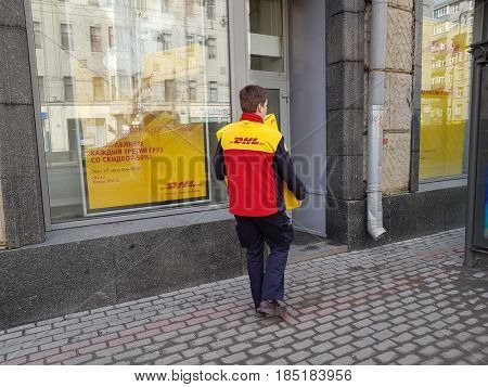 Moscow, Russia - March 13, 2017: Courier of a logistics company DHL carries boxes