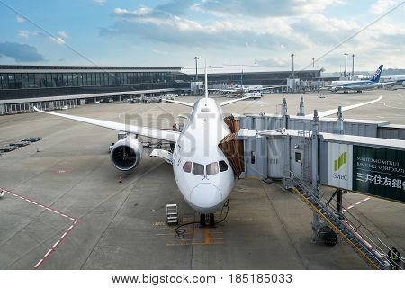 Tokyo Japan -March 6 2017: An ANA airplane loading off its passengers and cargo at Narita International airport