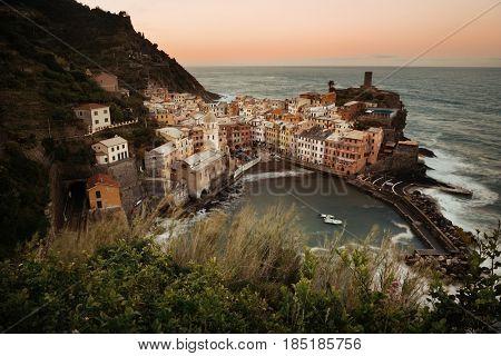 Vernazza bay with buildings on rocks over sea in Cinque Terre, Italy.