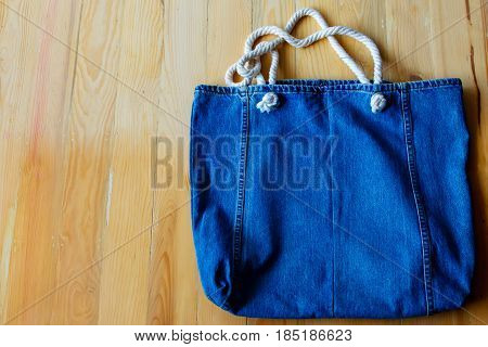 Jeans Bag on wood backgroundvintage styletop view.