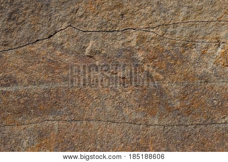Texture of brown stone (sandstone) with cracks closeup