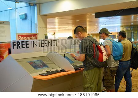 SINGAPORE - CIRCA SEPTEMBER, 2016: people use free internet access cumputer at Singapore Changi Airport. Changi Airport is one of the largest transportation hubs in Southeast Asia.