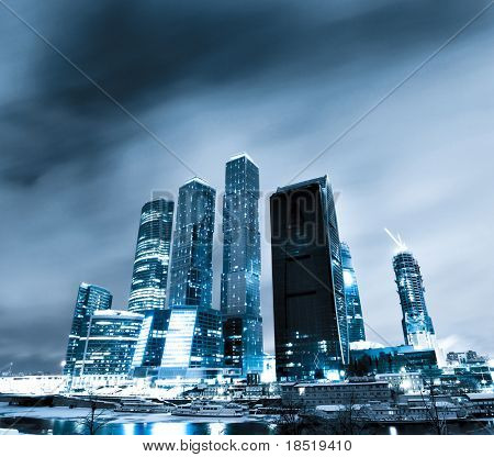 modern glass silhouettes of skyscrapers at night