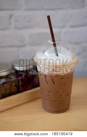 iced chocolate in coffee shop on wood table