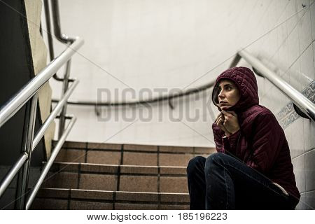 Cold Hopeless Woman Sitting Thoughtful on the Stairway