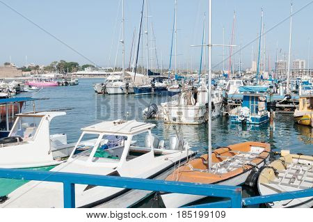 Yachts moored at the pier on the marina in the old town of Acre Israel