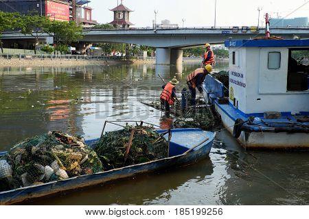 Sanitation Worker Picking Up Trash