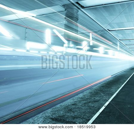 Fast moving train on underground platform