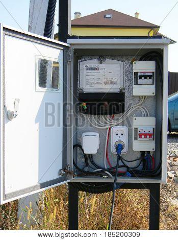 Electric power meter outdoor. House Watt hour Electric meter measurement tool exterior.