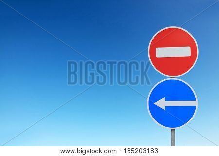 Road signs on the background of bright blue sky