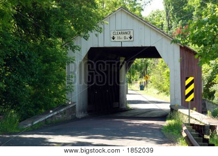 Nice Covered Bridge on road in Rual PA poster
