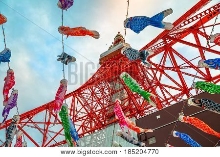 Tokyo, Japan - April 23, 2017: bottom view of colorful Koinobori at Tokyo Tower. Koinobori are carp-shaped wind socks traditionally flown in Japan to celebrate Children's Day during the Golden Week.