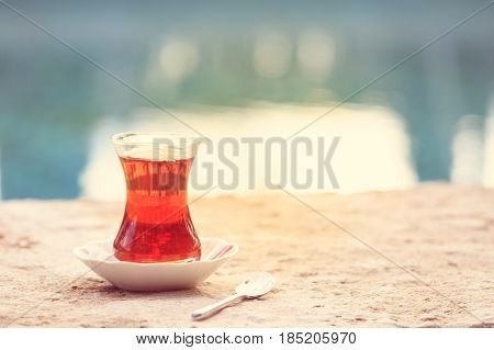 Hot Turkish Tea Outdoors Near Water. Turkish Tea And Traditional Turkish Culture Concept
