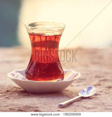 Hot Turkish Tea Outdoors Near Water. Turkish Tea And Traditional Turkish Culture Concept