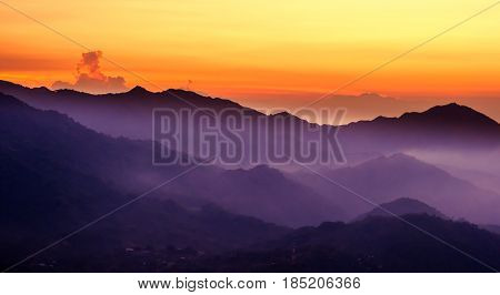 View on purple mountain with sunset over Minca in Colombia