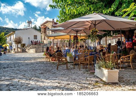 OMODOS CYPRUS - OCTOBER 04 2015: People sitting at an outdoors cafe in Omodos village Limassol District