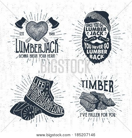 Hand drawn vintage badges set with textured tree trunk crossed axes bearded face boots and timber vector illustrations and inspirational lettering.
