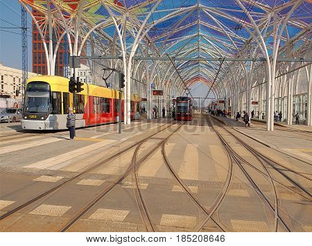 Trams in the center of Lodz .. Lodz, Poland - March 12, 2017 City tram under a roofed stop in the center of Lodz.