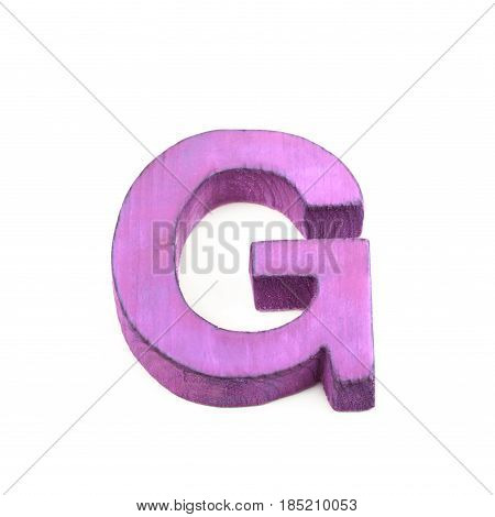 Single sawn wooden letter G symbol coated with paint isolated over the white background
