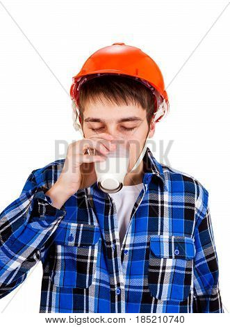 Young Man in Hard Hat drink a Milk Isolated on the White Background