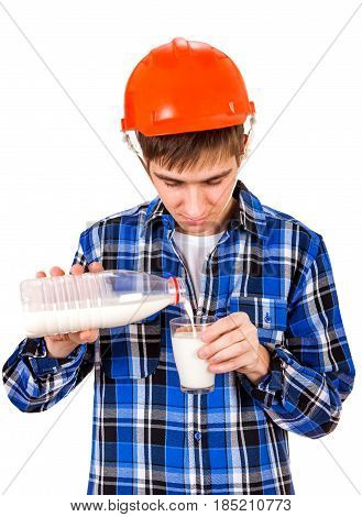 Young Man in Hard Hat pour the Milk in a Glass Isolated on the White Background