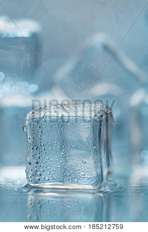 Cold melting ice cubes with water drops