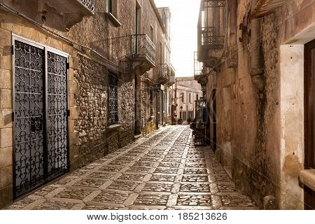 A cobbled medieval street in the historic town of Erice near Trapani in eastern Sicily Italy