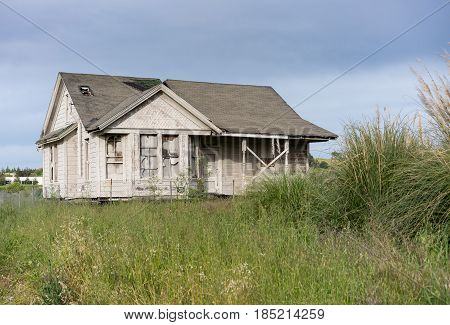 Single bungalow or family home abandoned and overgrown and in need of renovation or loving tender care