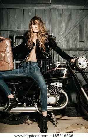 Woman Biker With Rusty Metallic Gas Can