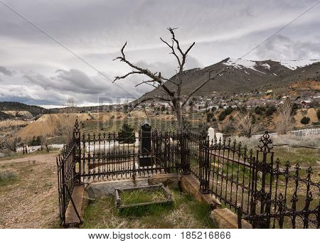 Old tombs and graves overlook the old town of Virginia City in Nevada, a center for gold and silver mining in the past