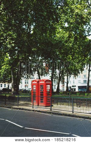 LONDON UK - August 10 2014: one of the characteristic red phone box in Central London in Mayfair