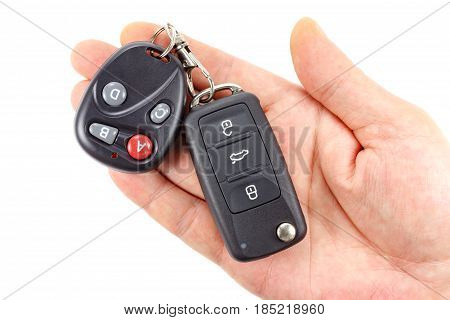 Ignition key with garage door remote control on the man's palm on a white background
