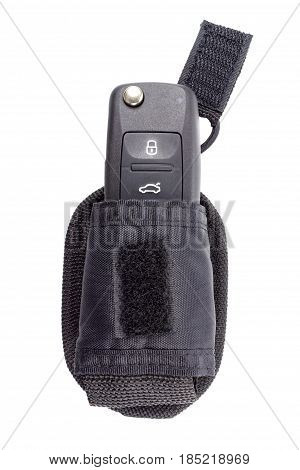 Closed ignition key in a storage pouch isolated on a white background