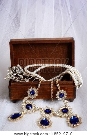 closeup of vintage necklaces with jewelry box