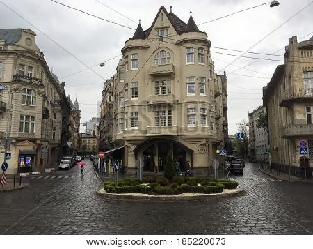 LVIV UKRAINE - APRIL 29: Beautiful cityscape - the crossroads of pavement and old houses in the center of Lviv on April 29 2017 in Lvov Ukraine