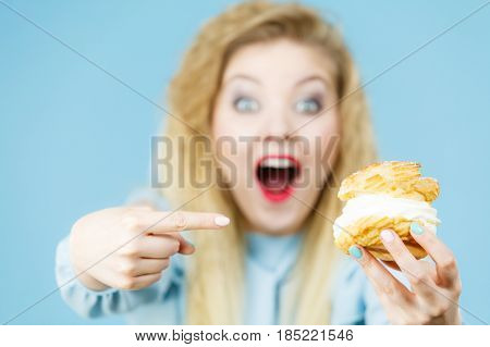 Funny Woman Holds Cream Puff Cake