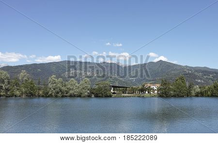 photo of lago del sole lake near Massa during summer time .