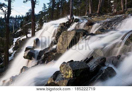 Sunrise at Emerald Bay on Lake Tahoe from the top of Lower Eagle Falls. Torrent of water from snow melt flows into the lake from Sierra Nevada Mountains poster