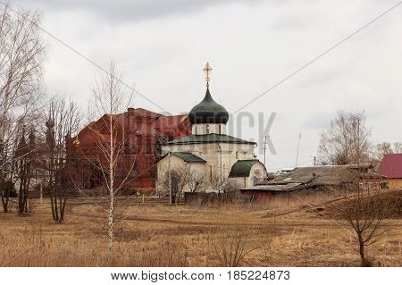 White-stone monastery with sky-blue domes at early morning