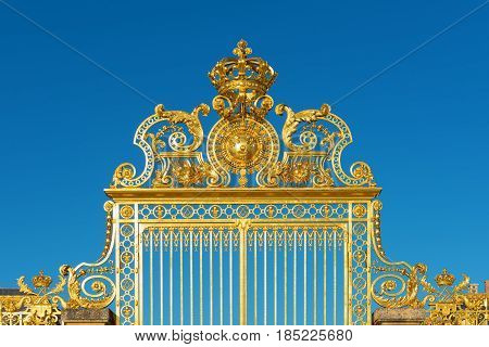 Detail of the golden Versailles palace gate entrance France.