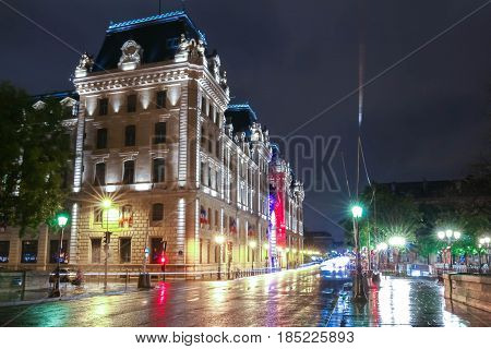 The palace of the Prefecture of Police of Paris at rainy night- France.