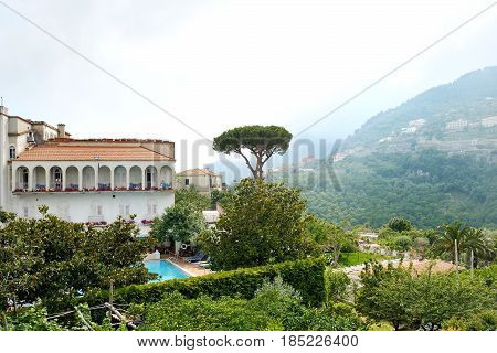 Ravello Amalfi Coast Italy - view of a white house with swimming pool and the green hills