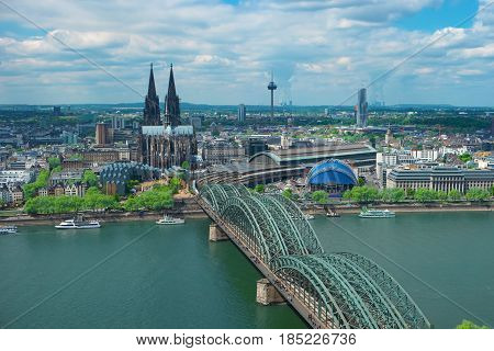 Skyline of Cologne with Cathedral Germany Europe. Famous most visited place symbol of Cologne. Beautiful european architecture. Aerial view of Cologne Cathedral Rhine river and Hohenzollern Bridge