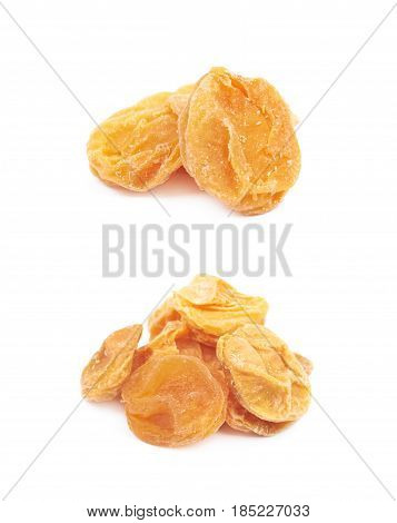 Pile of dried apricot fruits isolated over the white background, set of two different foreshortenings
