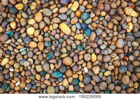 Abstract smooth round pebbles sea stone texture background.
