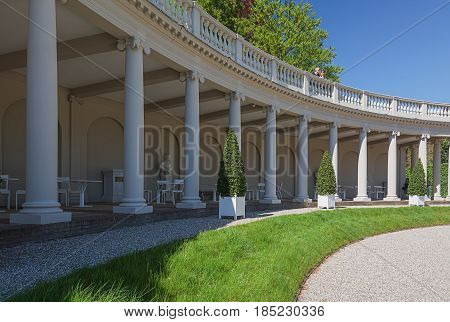 Apeldoorn, The Netherlands, May 8, 2016: The colonnade with colums in the baroque garden of The Loo Palace located in the outskirts of Apeldoorn in the Netherlands