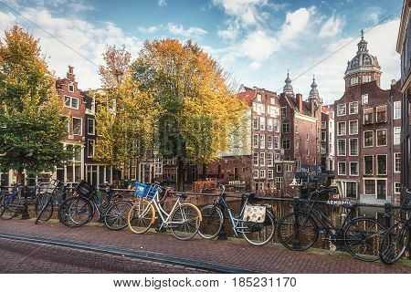 Amsterdam Netherlands - October 30 2016: The canal houses along the junction of the canals Oudezijds Voorburgwal and Oudezijds Achterburgwal in the old center of Amsterdam